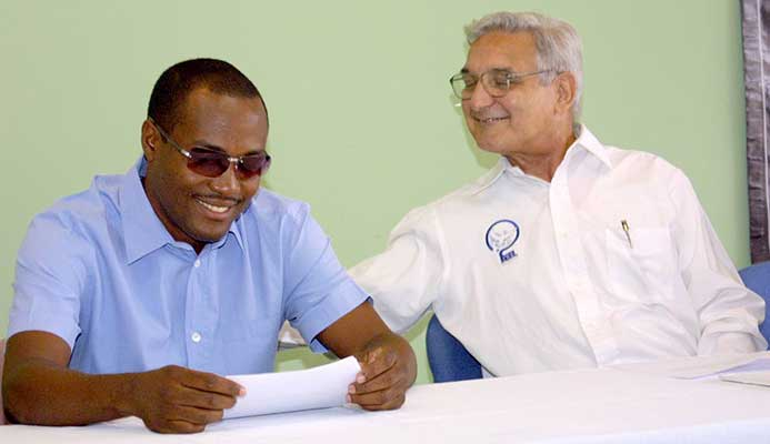 Clive Pantin with star batsman Brian Lara, a past student of Fatima College.