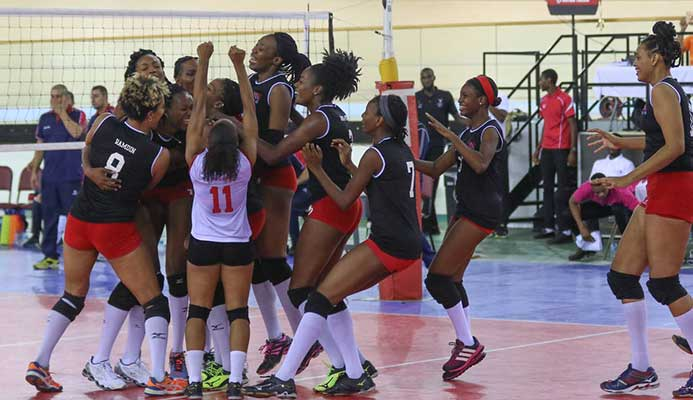 JAPAN HERE WE COME: Trinidad and Tobago's women volleyballers celebrate victory against Costa Rica to book their spot at the World Championships next year.