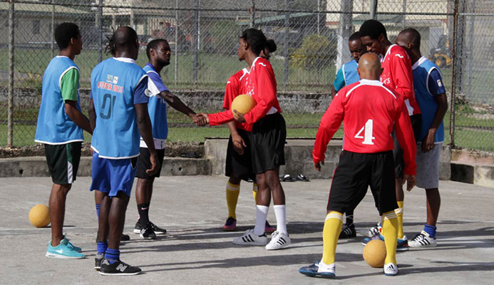 Futsal friendly: Maximum Security Prison (MSP) and Remand Yard inmates exchange greetings before a game of futsal at MSP in Arouca. PHOTOS BY ROGER JACOB