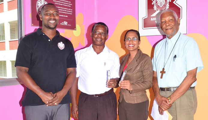 From left, football coach Richard Goddard, Project Chairman for the Bishops High School new sport field - Dr Alison Williams, Acting Principal Cindy Ramnarine and Chairman of the Board of Governors of the school, Archdeacon Kenneth Forrester, display pen drives that are on sale to help raise funds for the school's $4 million sports ground.