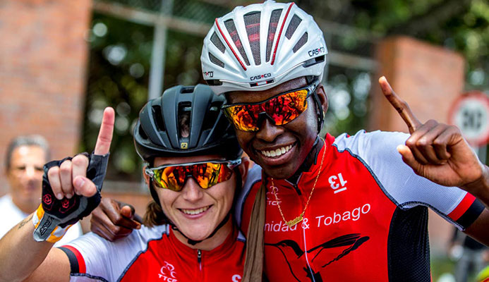 TT's Teneil Campbell, right, 2018 CAC Games road race champion, celebrates with compatriot Alexi Costa yesterday in Colombia.