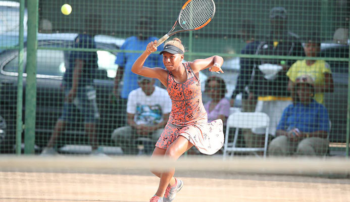 Solange Skeen plays a return shot during the Women's Singles Finals of the Shell Tranquillity Open Tennis Championships at Victoria Avenue, Port-of-Spain, yesterday. Photo by:Allan V. Crane