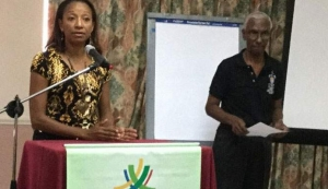 UWI PRESENTATION: University of the West Indies lecturer Sherlan Cabralis, left, makes a presentation during Saturday's First Citizens Sports Foundation National Governing Bodies (NGBs) Meet and Greet Seminar, at the Cascadia Hotel and Conference Centre. At right is senior Sports Foundation member, Dr Terry Ali.