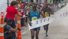 KENYAN PRIDE: Kenyan Stephen Mburi Njoroge crosses the line to win the Trinidad and Tobago International Marathon in a time of 2:23:04.3. His brother Simon(background) came in second with a time of 2:23:05.