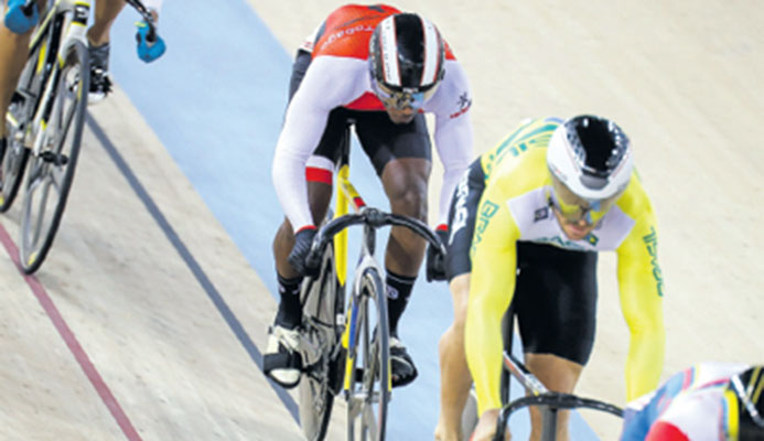 Kwesi Browne(TTO) during the first round of the Men's Keirin. He placed third and didn't automatically advance, but got into the semifinals with a win in the Repechage on day 2 of the Elite Pan American Track Championships at the National Cycling Centre, Couva, yesterday. PHOTO: RICHARD LYDER/ CA IMAGES