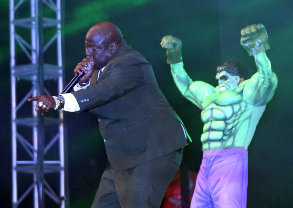 "Hulk power: Hulk flexes his muscles as Dexter ""Blaxx"" Stewart sings of the power of inner strength during his second place performance at the International Soca Monarch final, Queen's Park Savannah, Port of Spain on Friday night. Photos by Angelo Marcelle"