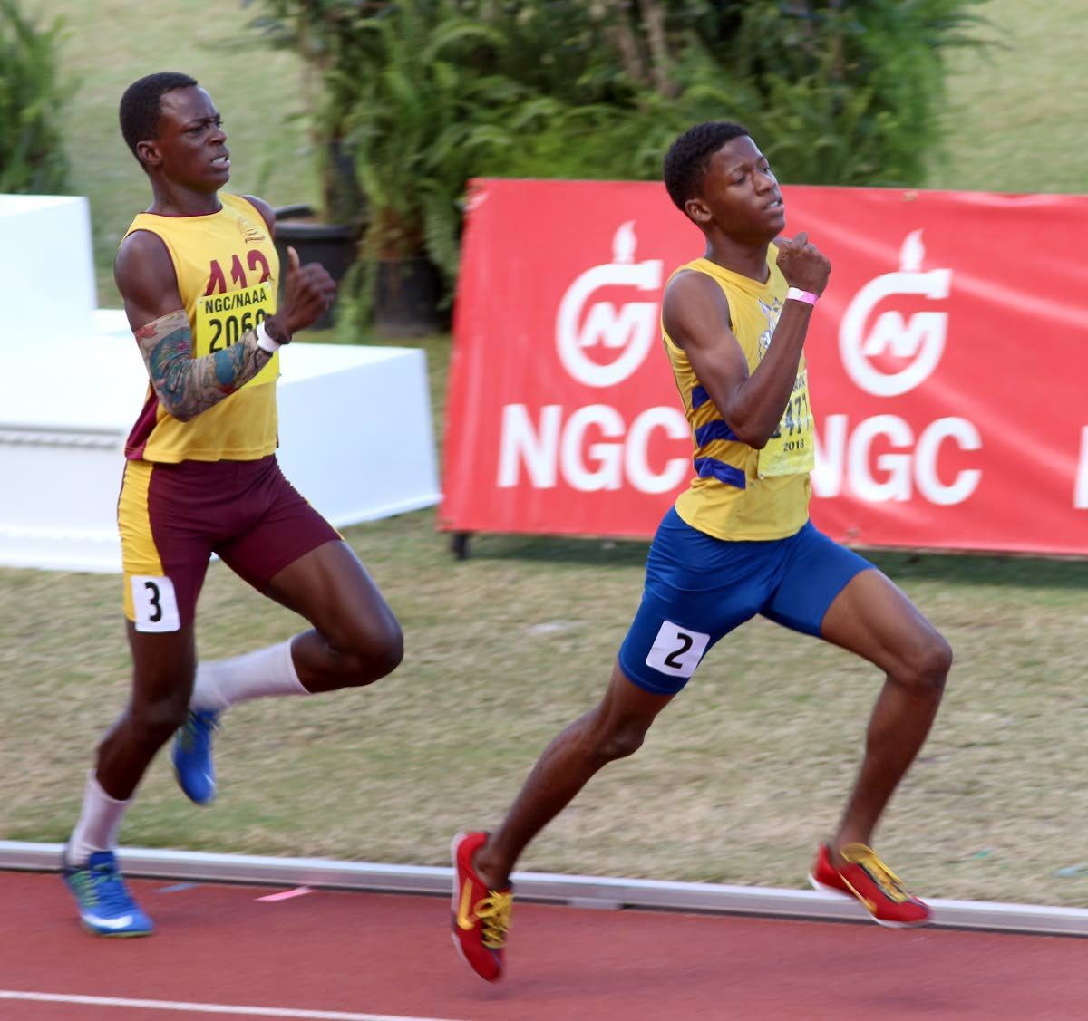 Mishak Peters, right, of Abilene Wildcats, wins the boys U17 800m final in a time of 2:03:54 secs, at the NGC/NAAA Jr Championships, Hasely Crawford Stadium, Port of Spain, yesterday.