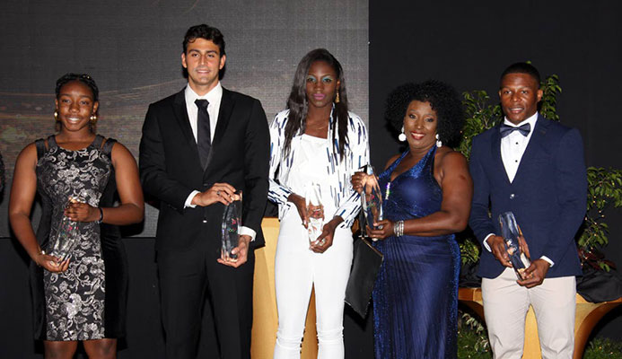 From left, Keona Yorke, sister of swimmer Kael Yorke, swimmer Dylan Carter, Shanique Bascombe, Yvette Wilson, mother of Jereem Richards and Nicholas Paul pose with their awards at the TTOC's annual Awards, held yesterday at the Hyatt Regency Hotel, Port of Spain.