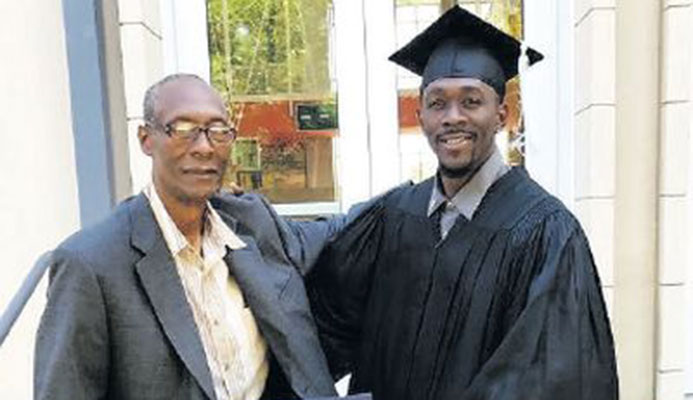 T&T's sprinter Marc Burns, right, with his father Alec after graduating with a Bachelor of Science degree in Exercise Science (Physical Conditioning and Performance) at Auburn University in Alabama, USA on Sunday.