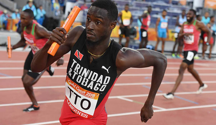 In this file photo, Jereem Richards competes in the men's 4x400m relay final during the 2018 Gold Coast Commonwealth Games at the Carrara Stadium on the Gold Coast on April 14,2018.