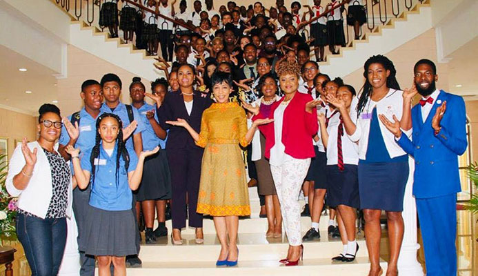 "Sharon Rowley, wife of Prime Minister Dr Keith Rowley, celebrates International Women's Day with students, government ministers and ""influencers"" yesterday at the Diplomatic Centre, St Ann's. The theme of this year's celebration was ""Balance for Better"" PHOTO Courtesty the Office of the Prime Minister"