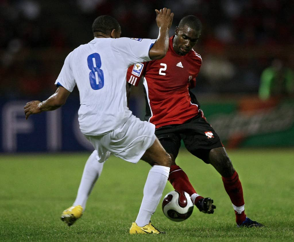 In this file photo, Trinidad & Tobago's Clyde Leon (R) vies for the ball with Honduras' Osman Chavez during their FIFA World Cup South Africa-2010 qualifier match at Hasely Crawford stadium in Port of Spain on March 28, 2009 -