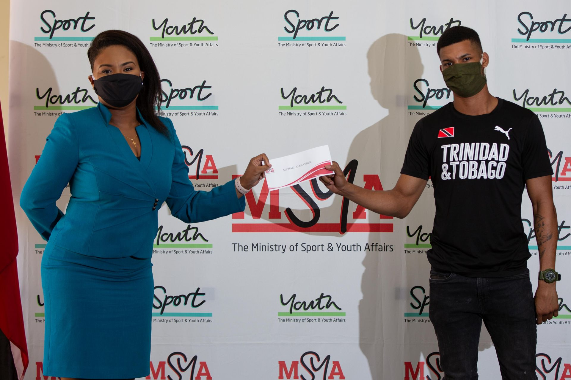 Sports and Youth Affairs Minister Shamfa Cujoe and boxer Michael Alexander in April 2020.  Kerron Savory