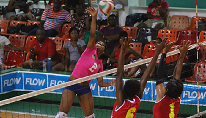 Westside's Malika Davidson,left, executes a kill during her team's match against Glamorgan in the women's finals of the Flow National Volleyball League at the Jean Pierre Complex, Port-of-Spain on Sunday.